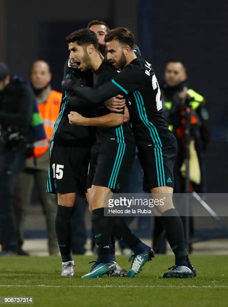 Marco Asensio of Real Madrid celebrates with team mates after scoring the opening goal during the Spanish Copa del Rey Quarter Final First Leg match...