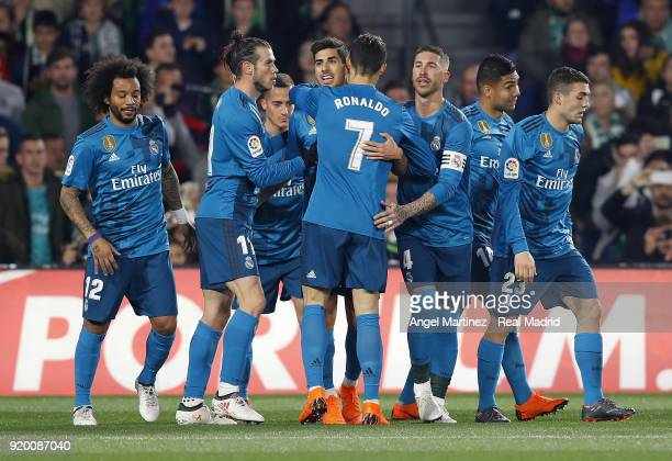 Marco Asensio of Real Madrid celebrates with team mates after scoring the opening goal during the La Liga match between Real Betis and Real Madrid at...