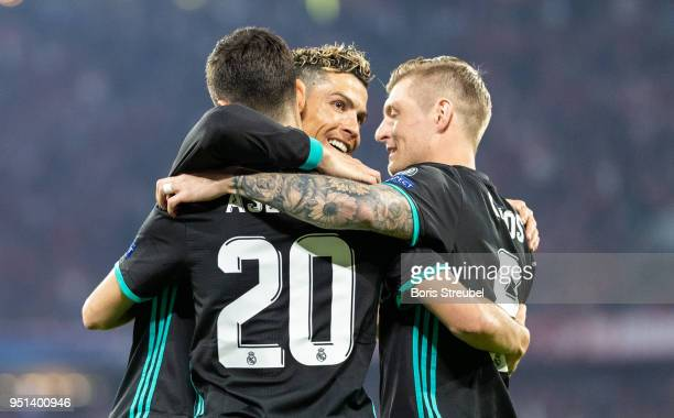Marco Asensio of Real Madrid celebrates with team mates after scoring his team's second goal during the UEFA Champions League Semi Final First Leg...