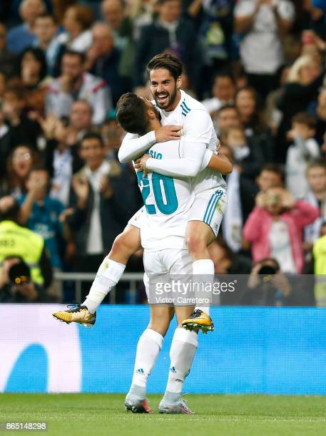 Marco Asensio of Real Madrid celebrates with teammate Isco Alarcon after scoring his team's second goal during the La Liga match between Real Madrid...