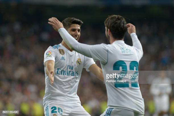 Marco Asensio of Real Madrid celebrates with teammate Isco Alarcon after scoring the second goal of his team during a match between Real Madrid and...