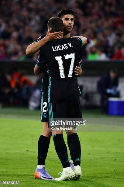 Marco Asensio of Real Madrid celebrates with teammate Lucas Vazquez after scoring his sides second goal during the UEFA Champions League Semi Final...