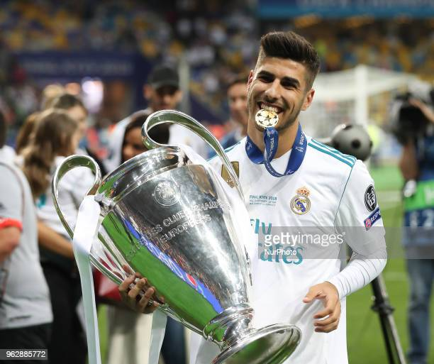 Marco Asensio of Real Madrid celebrates with the trophy after his side won the UEFA Champions League final between Real Madrid and Liverpool at NSC...
