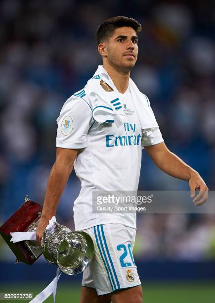 Marco Asensio of Real Madrid celebrates with the trophy after wining the Supercopa de Espana Supercopa Final 2nd Leg match between Real Madrid and FC...