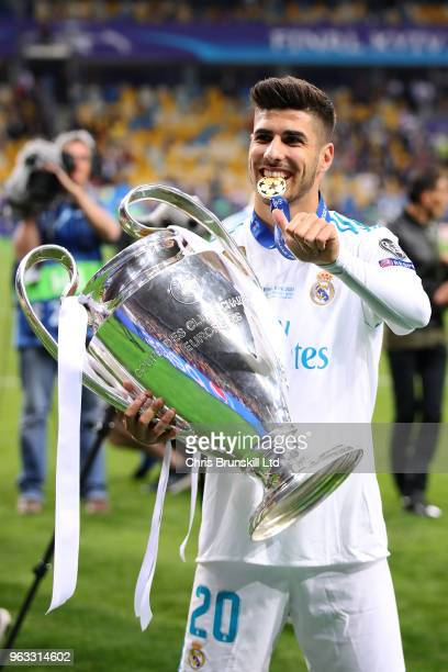 Marco Asensio of Real Madrid celebrates with the trophy following the UEFA Champions League final between Real Madrid and Liverpool at the NSC...