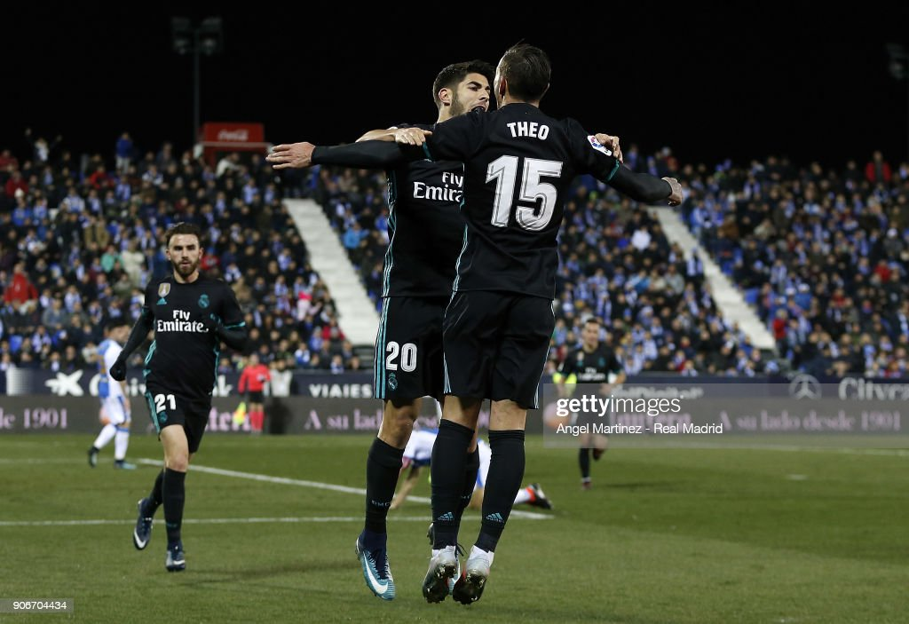 Marco Asensio (C) of Real Madrid celebrates with Theo Hernandez after scoring the opening goal during the Spanish Copa del Rey, Quarter Final, First Leg match between Leganes and Real Madrid at Estadio Municipal de Butarque on January 18, 2018 in Leganes, Spain.