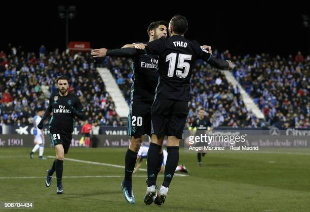 Marco Asensio of Real Madrid celebrates with Theo Hernandez after scoring the opening goal during the Spanish Copa del Rey Quarter Final First Leg...