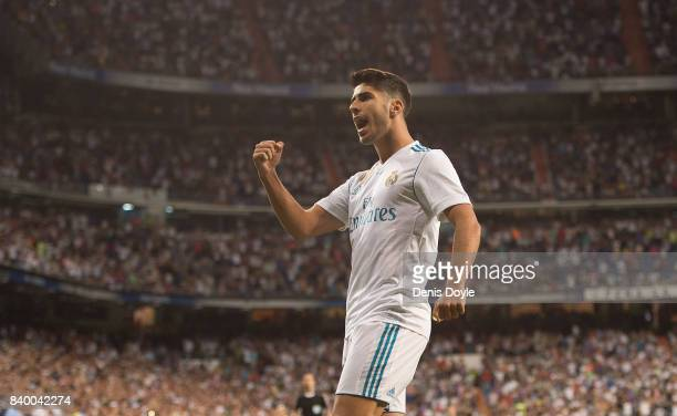 Marco Asensio of Real Madrid CF celebrates after scoring his teamÕs 1st goal during the La Liga match between Real Madrid CF and Valencia CF at...
