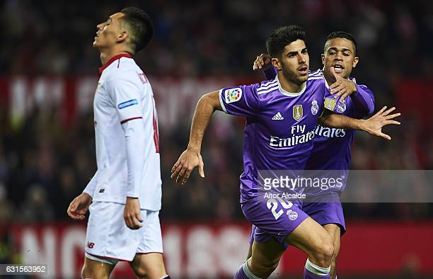 Marco Asensio of Real Madrid CF celebrates after scoring the first goal of Real Madrid CF with his team mate Mariano Diaz of Real Madrid CF during...