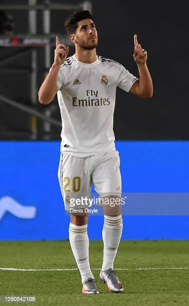Marco Asensio of Real Madrid CF celebrates scoring his teams second goal during the Liga match between Real Madrid CF and Valencia CF at Estadio...