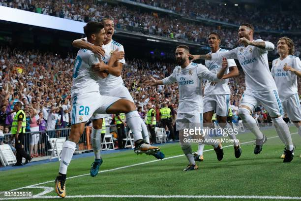 Marco Asensio of Real Madrid CF celebrates scoring their opening goal with teammates during the Supercopa de Espana Final 2nd Leg match between Real...