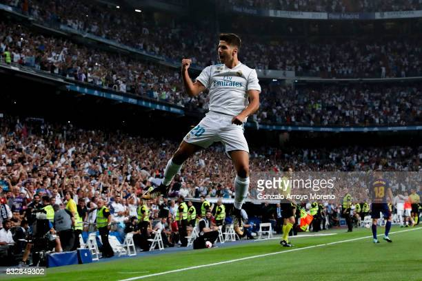 Marco Asensio of Real Madrid CF celebrates scoring their opening goal during the Supercopa de Espana Final 2nd Leg match between Real Madrid and FC...