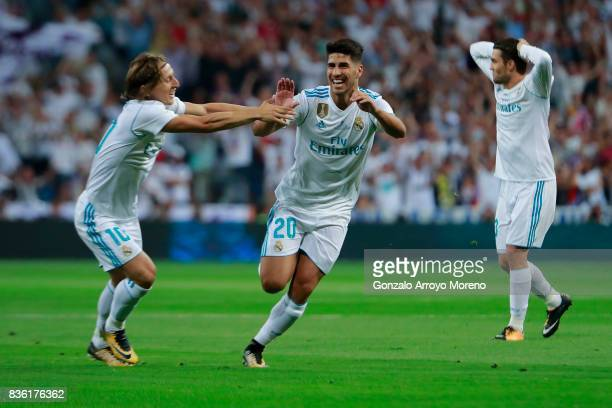 Marco Asensio of Real Madrid CF celebrates scoring their opening goal with teammate Luka Modric during the Supercopa de Espana Final 2nd Leg match...