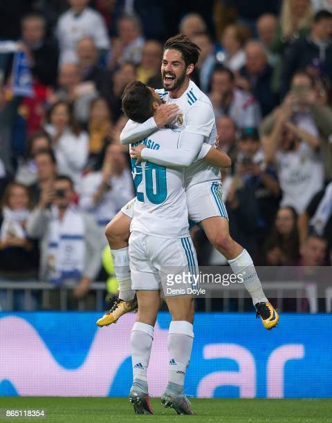 Marco Asensio of Real Madrid CF celebrates with Isco Alarcon after scoring his teamÕs 2nd goal during the La Liga match between Real Madrid and Eibar...