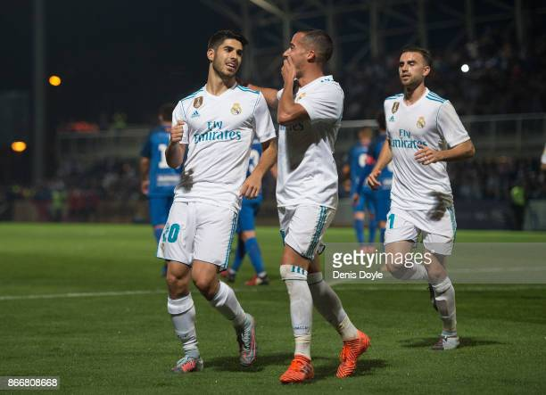 Marco Asensio of Real Madrid CF celebrates with Lucas Vazquez after scoring his teamÕs opening goal from a penalty kick during the Copa del Rey Round...