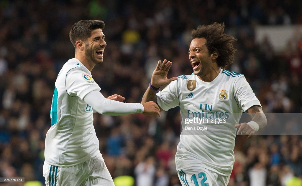Marco Asensio of Real Madrid CF celebrates with Marcelo after scoring his teamÕs 2nd goal during the La Liga match between Real Madrid and Las Palmas at Estadio Santiago Bernabeu on November 5, 2017 in Madrid, Spain.