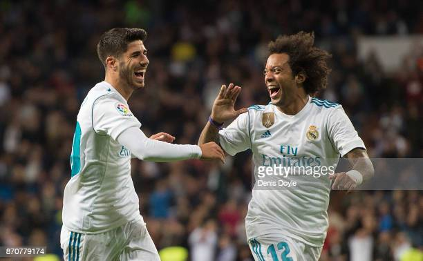 Marco Asensio of Real Madrid CF celebrates with Marcelo after scoring his teamÕs 2nd goal during the La Liga match between Real Madrid and Las Palmas...