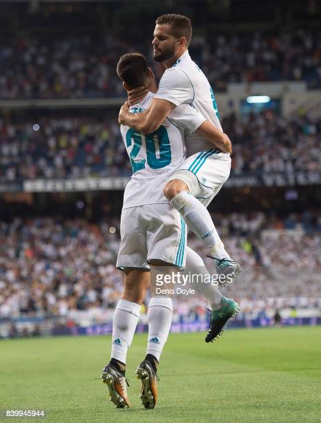 Marco Asensio of Real Madrid CF celebrates with Nacho after scoring his team's 1st goal during the La Liga match between Real Madrid CF and Valencia...