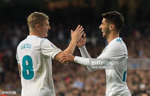 Marco Asensio of Real Madrid CF celebrates with Toni Kroos after scoring his team's 2nd goal during the La Liga match between Real Madrid and Las...