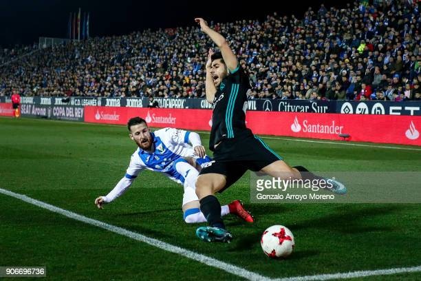 Marco Asensio of Real Madrid CF cis tackled by Roberto Roman Triguero alias Tito of Deportivo Leganes during the Copa del Rey quarter final first leg...