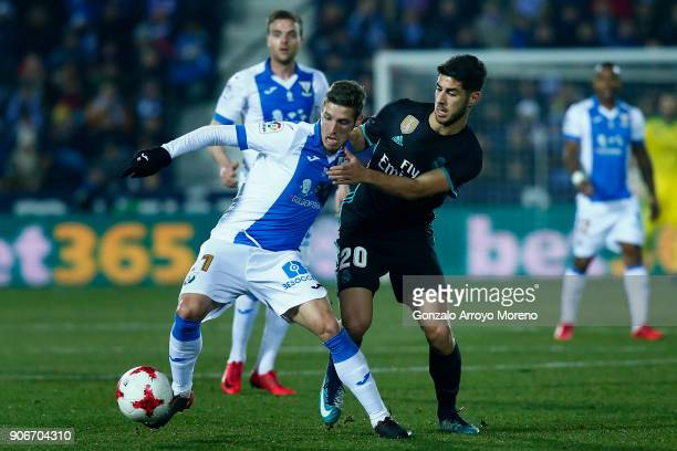 Marco Asensio of Real Madrid CF competes for the ball with Ruben Perez of Deportivo Leganes during the Copa del Rey quarter final first leg match...