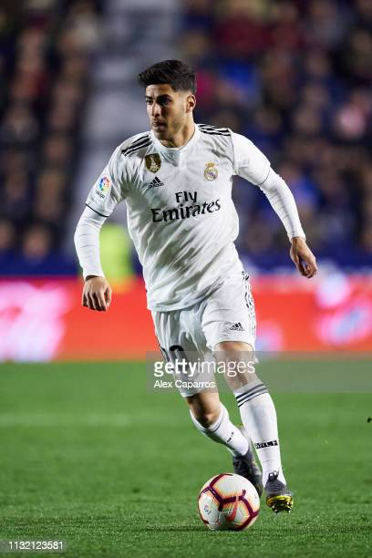 Marco Asensio of Real Madrid CF conducts the ball during the La Liga match between Levante UD and Real Madrid CF at Ciutat de Valencia on February 24...