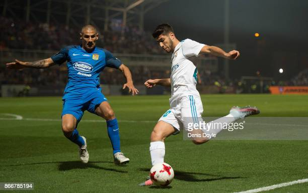 Marco Asensio of Real Madrid CF cross the ball past Cata Diaz of Fuenlabrada during the Copa del Rey Round of 32 First Leg match between Fuenlabrada...