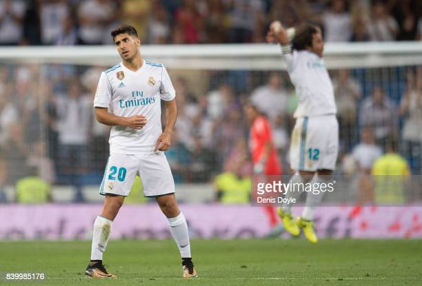 Marco Asensio of Real Madrid CF reacts after scoring his team's 2nd goal during the La Liga match between Real Madrid CF and Valencia CF at Estadio...