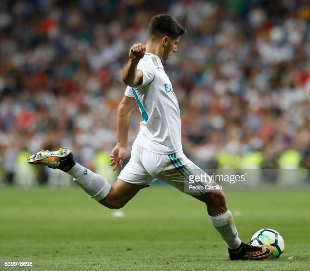 Marco Asensio of Real Madrid CF scores his 2nd goal during the La Liga match between Real Madrid and Valencia at Estadio Santiago Bernabeu on August...