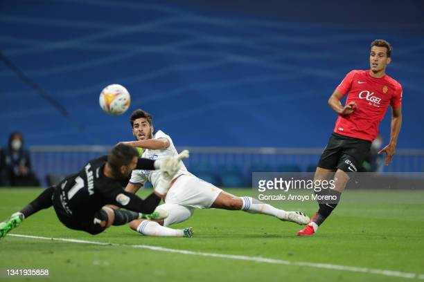 Marco Asensio of Real Madrid CF scores their third goal during the La Liga Santander match between Real Madrid CF and RCD Mallorca at Estadio...