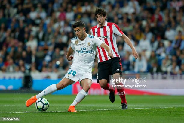 Marco Asensio of Real Madrid CF strikes the ball during the La Liga match between Real Madrid CF and Athletic Club de Bilbao at Estadio Santiago...