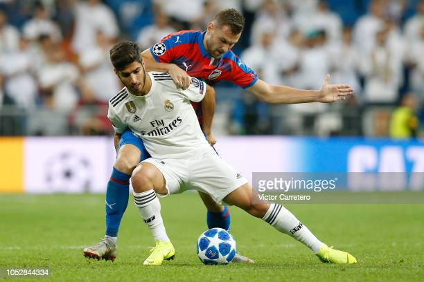 Marco Asensio of Real Madrid competes for the ball with Radim Reznik of Viktoria Plzen during the Group G match of the UEFA Champions League between...
