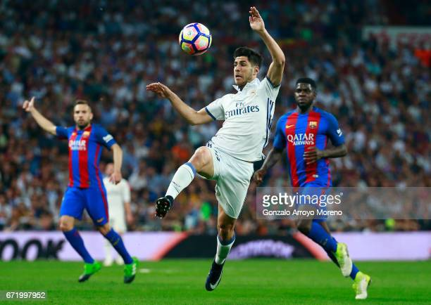 Marco Asensio of Real Madrid controls the ball during the La Liga match between Real Madrid CF and FC Barcelona at Estadio Bernabeu on April 23 2017...
