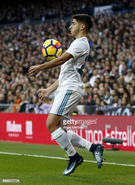 Marco Asensio of Real Madrid controls the ball during the La Liga match between Real Madrid and Sevilla at Estadio Santiago Bernabeu on December 9...