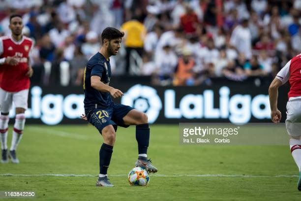 Marco Asensio of Real Madrid holds the ball during the International Champions Cup Friendly match between Arsenal F.C. And Real Madrid C.F. The match...
