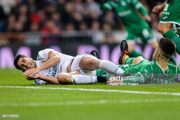 Marco Asensio of Real Madrid ifights for the ball with Unai Bustinza of CD Leganes during La Copa del Rey 201718 match between Real Madrid vs CD...