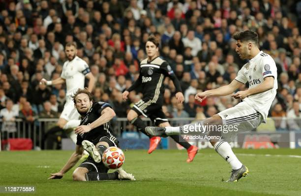 Marco Asensio of Real Madrid in action against Daley Blind of Ajax during UEFA Champions League Round of 16 second leg match between Real Madrid and...