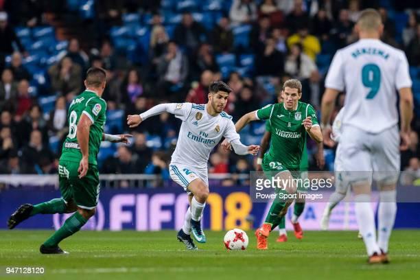 Marco Asensio of Real Madrid in action against Darko Brasanac of CD Leganes during La Copa del Rey 201718 match between Real Madrid vs CD Leganes at...