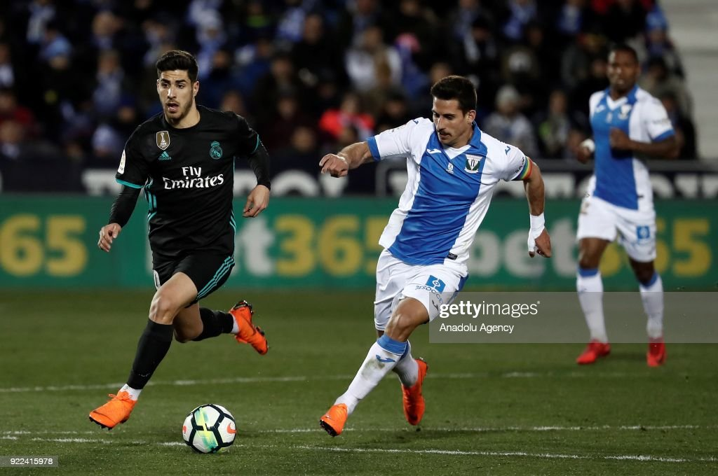 Marco Asensio of Real Madrid in action against Gabriel of Leganes during the La Liga football match between Leganes and Real Madrid at the Estadio Municipal Butarque in Madrid, Spain on February 21, 2018.