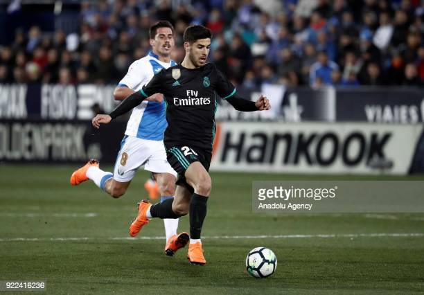 Marco Asensio of Real Madrid in action against Gabriel of Leganes during the La Liga football match between Leganes and Real Madrid at the Estadio...