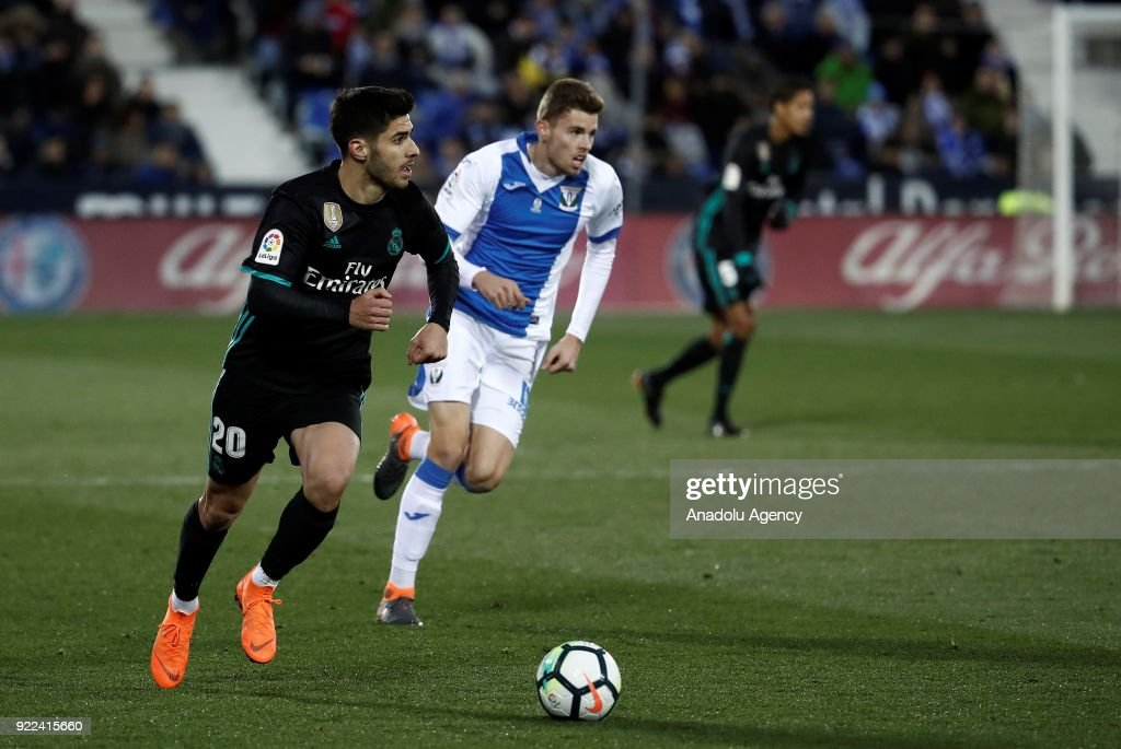 Marco Asensio of Real Madrid in action against Gerard Gumbau of Leganes during the La Liga football match between Leganes and Real Madrid at the Estadio Municipal Butarque in Madrid, Spain on February 21, 2018.