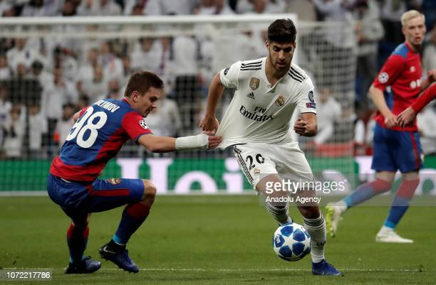 Marco Asensio of Real Madrid in action against Ivan Oblyakov of CSKA Moscow during the UEFA Champions League match between Real Madrid and CSKA...