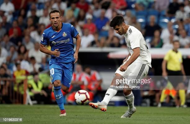 Marco Asensio of Real Madrid in action against Nemanja Maksimovic of Getafe during La Liga soccer match between Real Madrid and Getafe at Santiago...