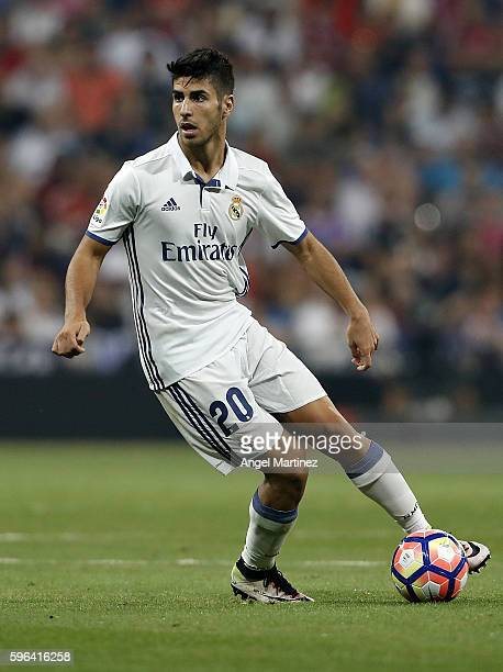 Marco Asensio of Real Madrid in action during the La Liga match between Real Madrid CF and RC Celta de Vigo at Estadio Santiago Bernabeu on August 27...