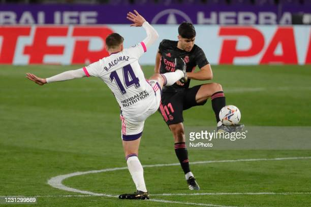 Marco Asensio of Real Madrid in action with Ruben Alcaraz of Real Valladolid during the La Liga match between Real Valladolid and Real Madrid at Jose...
