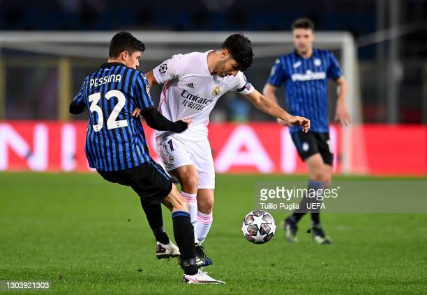 Marco Asensio of Real Madrid is challenged by Matteo Pessina of Atalanta B.C. During the UEFA Champions League Round of 16 match between Atalanta and...