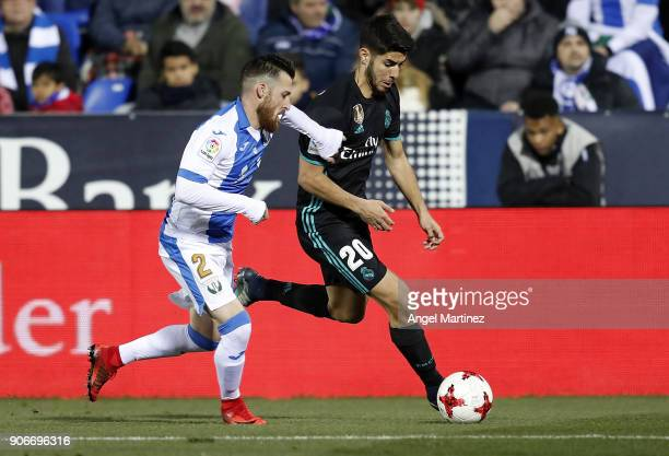 Marco Asensio of Real Madrid is challenged by Tito of Leganes during the Spanish Copa del Rey Quarter Final First Leg match between Leganes and Real...