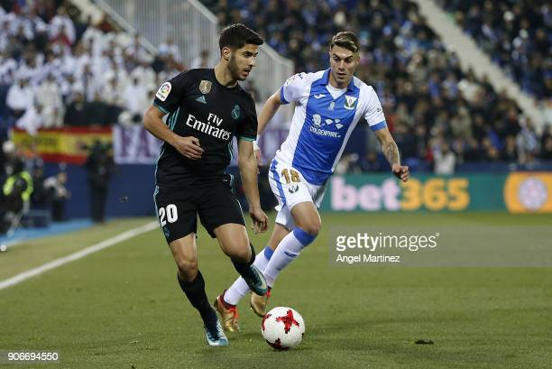 Marco Asensio of Real Madrid is chased by Jose Naranjo of Leganes during the Spanish Copa del Rey Quarter Final First Leg match between Leganes and...