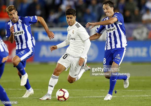 Marco Asensio of Real Madrid is chased by Tomas Pina of Deportivo Alaves during the La Liga match between Deportivo Alaves and Real Madrid at Estadio...