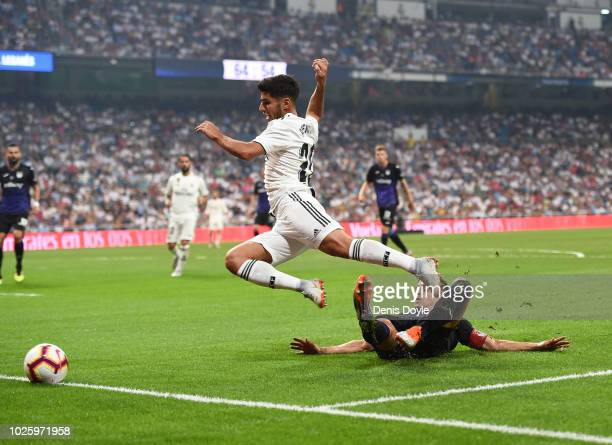 Marco Asensio of Real Madrid is fouled in the penalty area by Unai Bustinza of CD Leganes during the La Liga match between Real Madrid CF and CD...